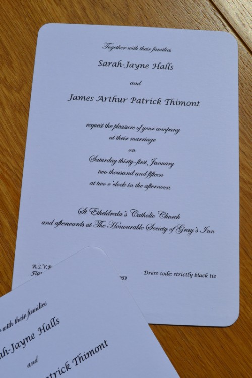 Wedding invitations printed in black thermography on gilt edged cards